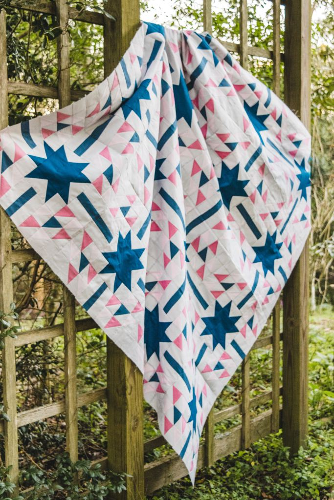 Aglow Quilt featuring Half Square Triangles made perfect with AccuQuilt